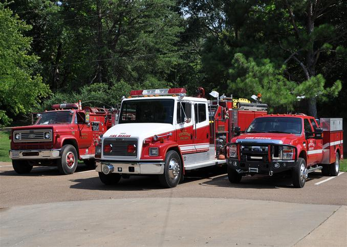 3 different fire trucks are parked next to each other
